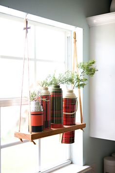 DIY Hanging vintage thermos display shelf.