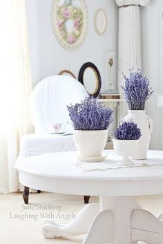 H o m e . D e c o r- a pop ofcolour like this lavender breaks the white and looks spectacular!