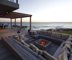 Party pit on the beach with outdoor fireplace.