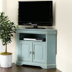 Big screen entertainment is coming to you. This space-saving corner media console holds up to a 46in screen at just the right height for family…