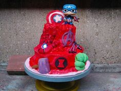 Avengers airbrushed cake with Captain America Funko Pop topper. Iron Man's hand lights up!