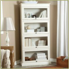 storage white bookcase with glass door for elgant interior with