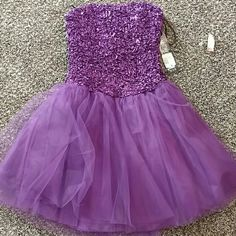 Masquerade cocktail dress Purple dress with tulle bottle and textured top. Dresses Strapless