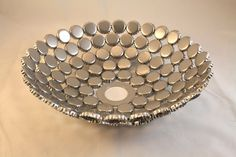 This decorative dish made from bottle caps is just too cute!