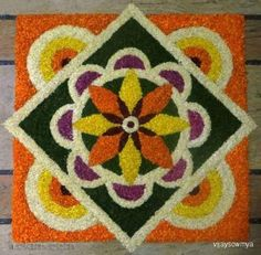 Pookalam designs are flower rangoli designs made using flower, flower petals and leaves.Pookalam rangoli designs are made during Onam, Diwali and Pongal. Rangoli Designs Latest, Rangoli Designs Flower, Small Rangoli Design, Rangoli Patterns, Colorful Rangoli Designs, Rangoli Ideas, Rangoli Designs Diwali, Rangoli Designs Images, Diwali Rangoli