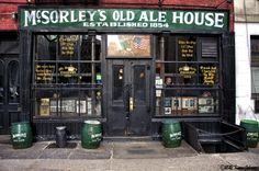 "McSorley's Old Ale House Est. 1854.  Oldest pub in NYC.  When you order a beer, they give you two.  They carry only two types: dark and pale.  Trivia: McSorley's didn't allow women until the Supreme Court ordered them in 1970.  So they said ""Foine, but we're not givin' 'em a bathroom.""  If you look at the light fixtures above the bar you'll see wishbones hanging off them.  They were left by neighborhood boys who went off to fight in WWI and didn't return.  McSorley's slogan: Be Good or Be…"