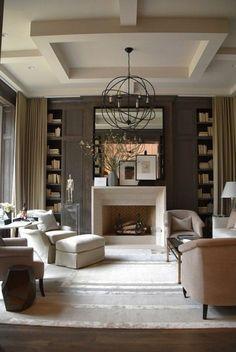 Wohnzimmer grau ein Kamin, bequemen Möbel, vintage Teppich, ausgefallener Kronleuchter