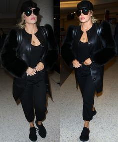 Khloe was dressed casually in a black tank top and black pants combo styled with a black leather cap and oversized aviator sunglasses