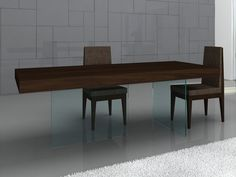 J&M Float Dining Table - The glass base renders an incomparable uniqueness. With the walnut wooden frame. Dimensions: 78 L x 39 W x 29 H