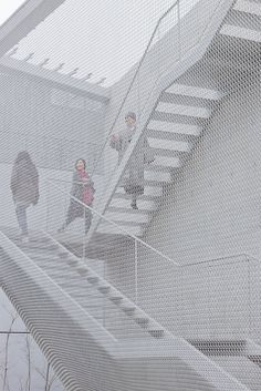 good idea for covering your outdoor staircase with net. |An Art Gallery With A Ghostly Chain Mail Skin |
