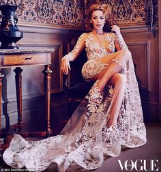 Sheer darling: Kylie stuns in a sheer lace gown complete with long train in a fashion shoot for Vogue Australia