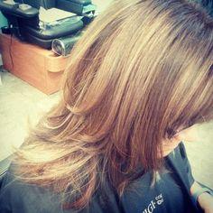 Mahogany brown hair color, caramel highlights, layered haircut with bangs