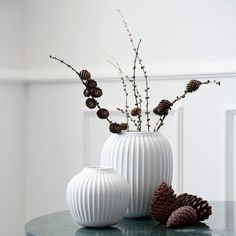 Although a successful painter and craftsman in his day, Svend Hammershøi is best remembered for the stunning vessels from which this range takes its inspiration. Designed in 1904 for Danish ceramicists Kähler, a brand whose heritage stretches back over 175 years, the decorative furrows of the original vases have been reinterpreted to produce this tall vase with glossy white glaze.