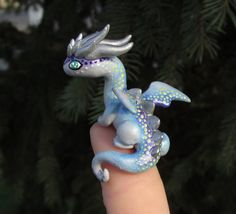 Another little dragon sculpt I've been working on. I need to get a base for him to sit on. I call him the Milky Way Dragon because I originally made the white spots to represent stars upon his back...