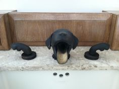 Dog faucet - It's a one of a kind.  Roman's Plumbing, Inc. inquired on where and how to purchase these faucets but it turns out they are special made, one of a kinds. The designer has stated that she thinks the person who made this faucet may not be making them anymore.