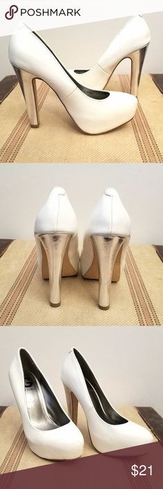 "GUESS White Leather Chunky Silver Heeled Platforms In great condition, a few nicks on the heels. 5"" Heels, 1"" Platform Size 5.5  Offers accepted only on bundles; as much as I love what I do I need to make $ for the time involved in finding, cleaning, photographing, editing, listing, storing & mailing each item.  DISCLAIMER: This is a second hand vintage item and so being may come with some slight undetected stains, wear or defects. I have tried to describe and photograph each item so as to…"