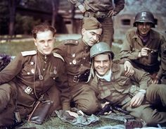 Soviet and US officers near Elbe River, Germany, 28 Apr 1945; note left Soviet officer's TT-33, center Soviet capt's Luger in belt, right US lieutenant's holstered Colt 1911 and in-hand Walther P38