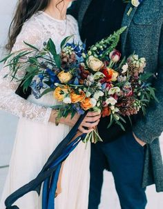 Everyone and their mother is in love with daring, moody wedding flowers right now. We're calling a continuation of this moody obsession, but with a bit of a color pop. Spring is coming eventually after all…right?