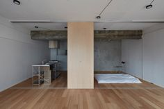 To make better use of space inside this small Tokyo flat, local studio FrontOfficeTokyo replaced almost all of the walls with multi-functional box units and a series of sliding partitions