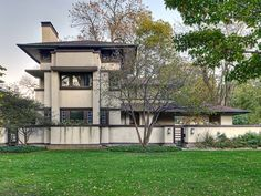 This Wright-designed, three-story Prairie house has an extended south porch, stepped roofs, and vertical piers on the west elevation, which tie the entire composition together visually.