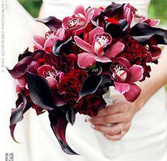 wedding flowers:  Black Magic roses, plum calla lilies, deep-red peonies, ranunculus, cymbidium orchids