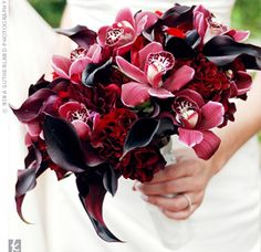 Black Magic roses, plum calla lilies, deep-red peonies and ranunculus