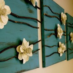 Home made wall art. The flowers are made out of paper that has writing on it (printing paper) or newspaper, painted with clear paint
