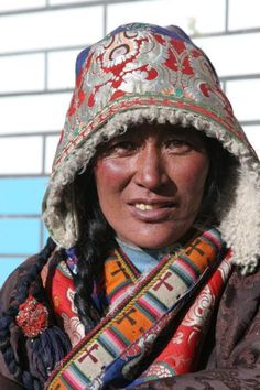 Picture of Sun shining on face of traditionally dresses Amdo Tibetan woman