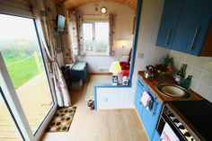 One of several shepherds hut grouped together with built-in beds in Swansea, Wales, UK.