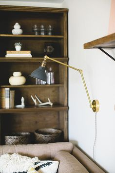 "Sneak Peek: A San Diego Home Full of Handmade Touches. ""One of my favorite pieces in our living room is this industrial light by Long Made Co. If there's one thing you'll learn from this sneak peak, it's that I'm a sucker for Etsy, or more importantly, vintage and handmade goods."" #sneakpeek"