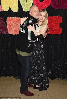 Picture perfect: The 24-year-old cosied up to American Horror Story creator Ryan Murphy...