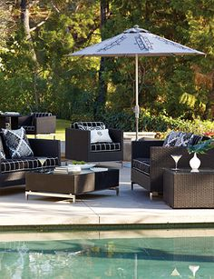 Black furniture can transform your backyard into a modern pool side hang out.