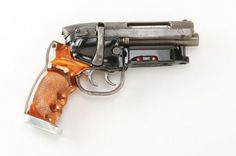 """Arguably one of the single most important weapons in Science Fiction history is the hero firing blaster used by Rick Deckard (Harrison Ford) to """"retire"""" replicants in Ridley Scott's timeless Sci-Fi classic Blade Runner. Harrison Ford, Rifles, Revolver, Blade Runner Blaster, Rick Deckard, Future Weapons, Sci Fi Weapons, Steampunk Weapons, Prop Design"""