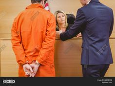 Lawyer and judge speaking next to the criminal in handcuffs in the court room Stock Photo & Stock Images | Bigstock