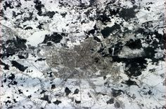 Success! For months we tried to get a clear photo of Minsk, Belarus, hometown of happy crewmate Oleg Novitsky.  Credit: Chris Hadfield Twitter account