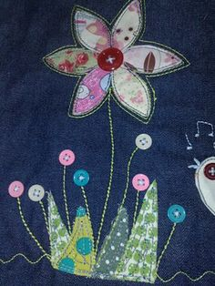 Applique on Denim... so cool looking... would look cool on a bag or quilt