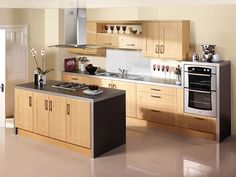 Inexpensive Kitchen Designs Ideas: Terrific Simple Kitchen Styles With Small Kitchen Island On Glossy White Flooring Also Wooden Cabinets And Kitchenware Along With Electric Oven Stoves ~ workdon.com Kitchen Design Inspiration