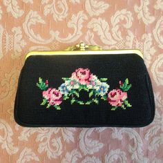 Lovely handmade petit point small purse lined with black silk. Black padded sides with floral design on each side of pink roses. Two scalloped brass snaps clasp a central post at top, open two inner compartments, each with side pocket. Label reads Made in The Peoples Republic of China along with Chinese characters.  Height 10cm (4) includes clasp Width 15.5cm (6 1/4) Depth 2.5cm (1)  Excellent condition.  Please contact me if you would like a price for international shipping.