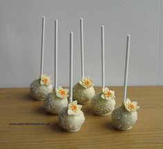 Flower themed Cakepops, cake, pops, white, yellow, wedding, favours,http://www.facebook.com/welcometreats