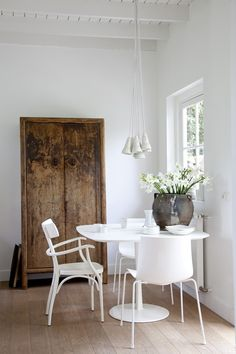 Old timber cupboard contrast with all white furniture