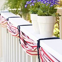 Bunch tablecloth to railing & secure w/blue ribbon
