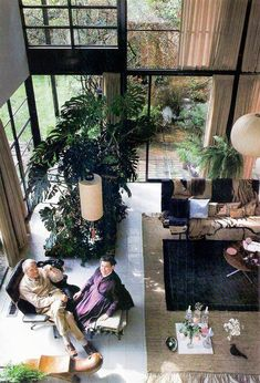 Charles and Ray Eames in their house