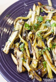 Garlic Roasted Eggplant!  Perfectly roasted eggplant infused with garlic and topped with parmesan and herbs.  Simple dinnier side dish.