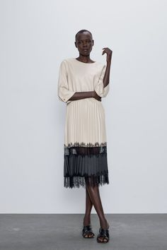Round neck midi dress with below-the-elbow length sleeves. contrasting fabric detail at hem. back opening and metal button closure. Midi Dress With Sleeves, Lace Skirt, Zara Outfit, Zara Home Stores, Faux Leather Dress, Metal Buttons, Zara Dresses, Zara Women, Boyshorts
