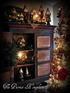 My Santas - how nice Prim Christmas.in an old pie safe with belsnickles & candlelight. Primitive Christmas Decorating, Primitive Country Christmas, Prim Christmas, All Things Christmas, Vintage Christmas, Christmas Holidays, Christmas Trees, Christmas Vignette, Xmas