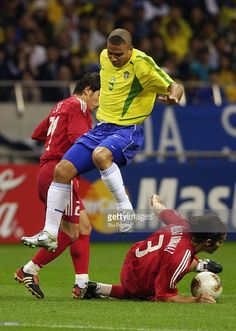 Ronaldo of Brazil is tackled by Bulent Korkmaz of Turkey during the FIFA World Cup Finals 2002 Semi-Final match played at the Saitama Stadium, in Saitama-Ken, Japan on June 26, 2002. Brazil won the match 1-0. DIGITAL