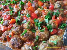 Baked mini koftes in pepper and tomato sauce.