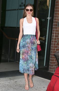 Miranda Kerr Never Has an Off Day — See How She Does It: Miranda tucked a white tank into a floral Topshop skirt, then added nude Alexander Wang sandals, Miu Miu sunglasses, and a bold pink bag.