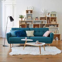 Jolie déco de salon avec canapé bleu canard type retro vintage scandinave