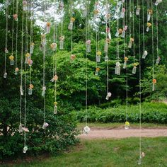 Outdoor Hanging Decor - photo by: Our Labor Of Love Event Planning: Ashley Baber Weddings Location: Barnsley Gardens Resort Decorations: amy osaba event.floral.design